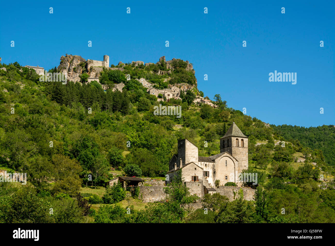 Grands Causses Natural Regional Park. Church of ND des Treilles, Saint Veran village in valley of riviere Dourbie, - Stock Image