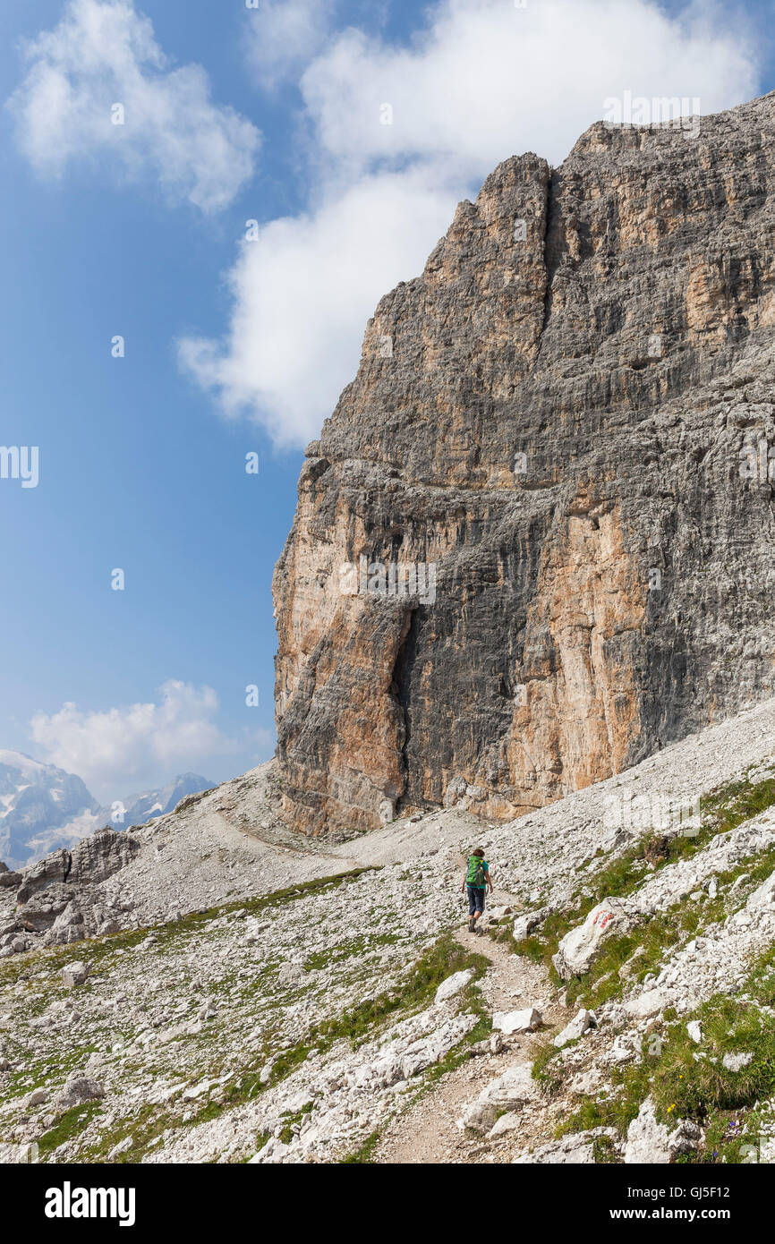 Traveller (female) in the stony Sella-ring bath, climbing to the Piz Boé, Dolomites, South Tyrol, Italy, Europe, - Stock Image