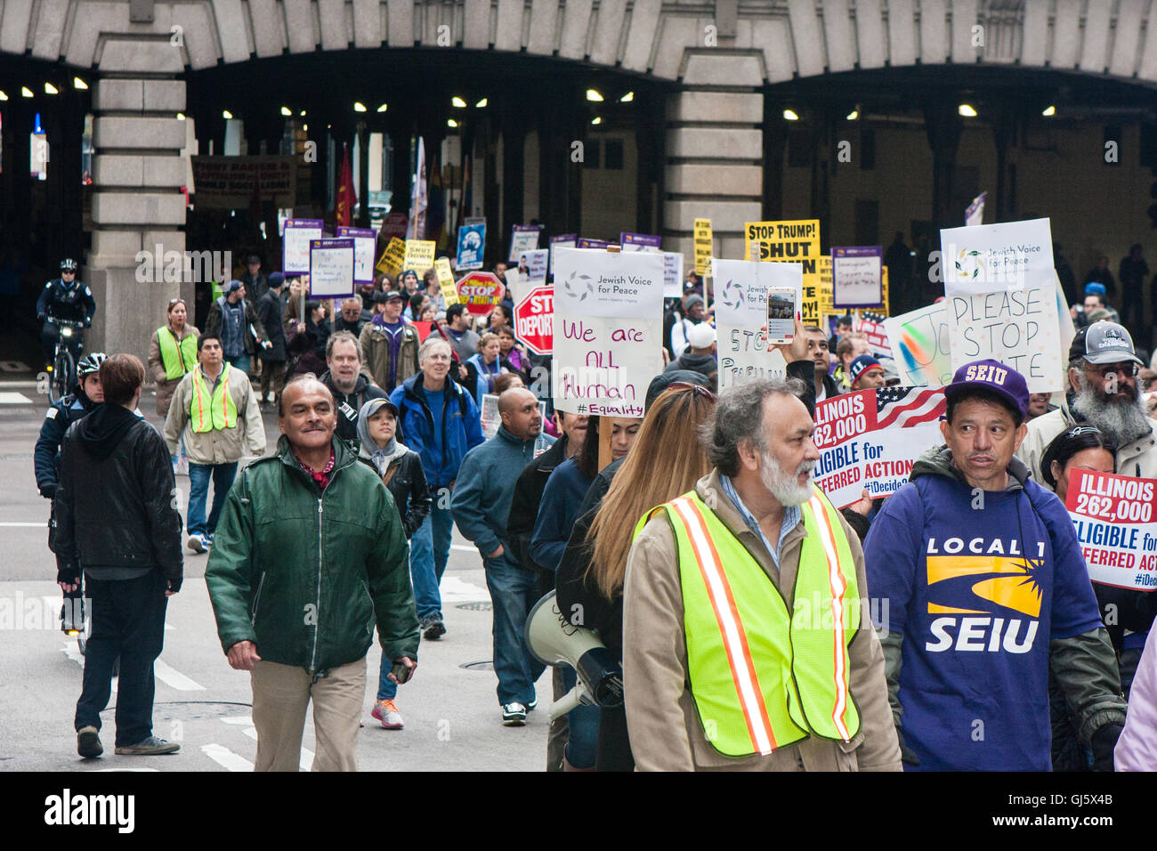 Hundreds of marchers unite on May Day in Chicago to protest Donald Trump's anti immigrant rhetoric. - Stock Image