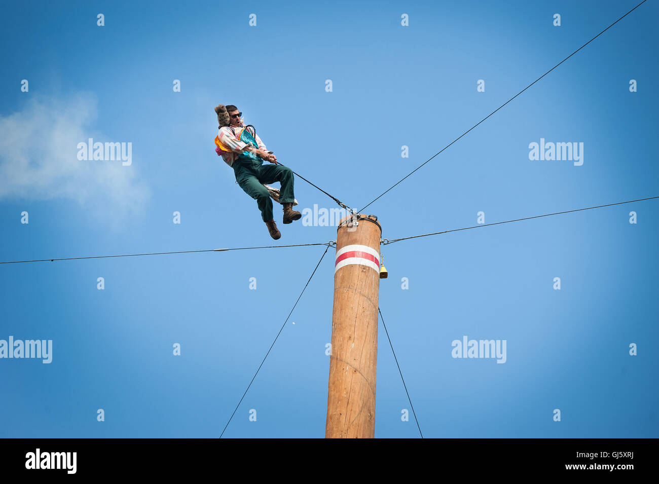 Brian Bartow does the famous tree event.  The Squamish Loggers Day Loggers Sports event.  Squamish BC, Canada - Stock Image