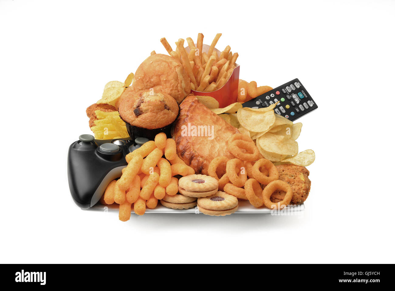Unhealthy  food and lifestyle on a plate with junk food chips crisps with remote control, console bad diet obesity - Stock Image