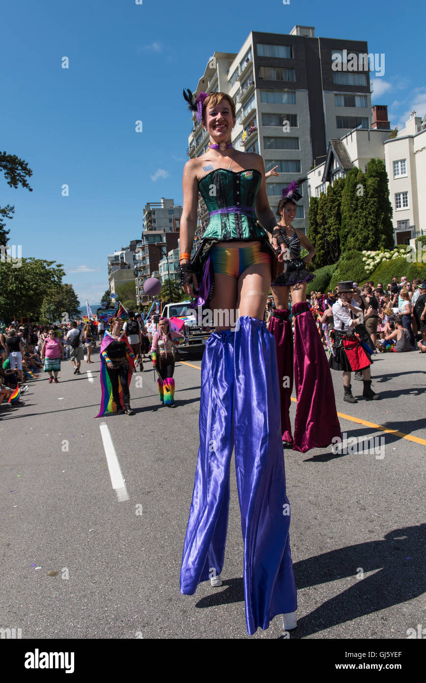 Pride parade participant on stilts in a colourful costume, 2016 Vancouver British Columbia - Stock Image