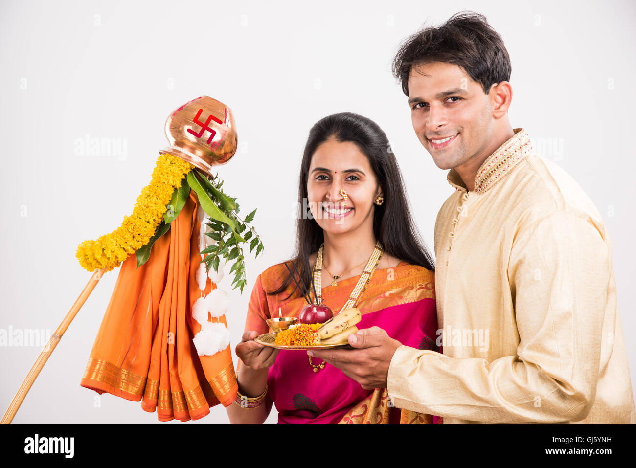 3811c854b9 smart indian couple in traditional wear performing gudhi padwa puja, asian  couple & puja thali