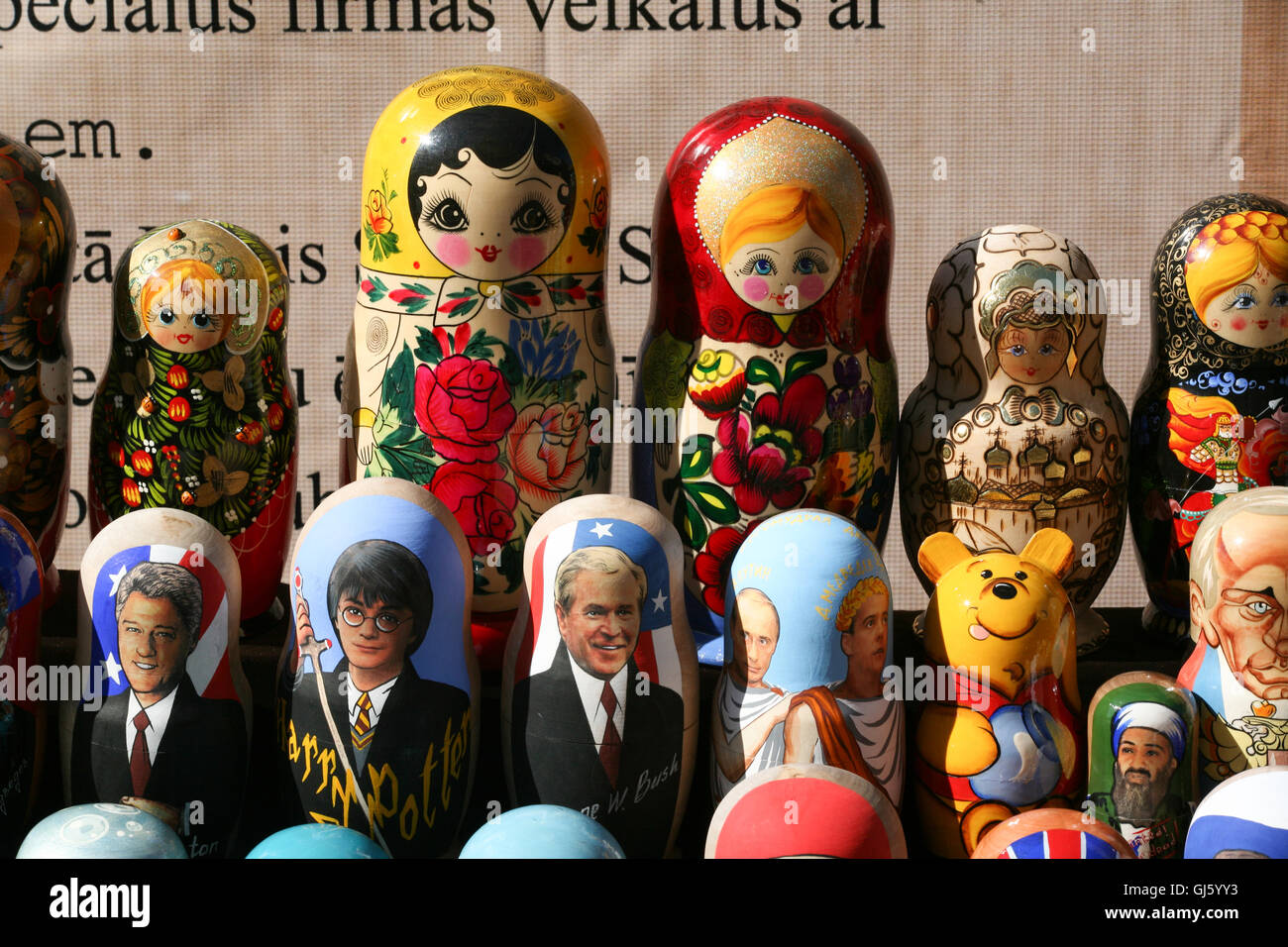 Matryoshka doll /Russian Dolls,with typical motherly images along with dolls of Clinton, Bush, Harry Potter and - Stock Image