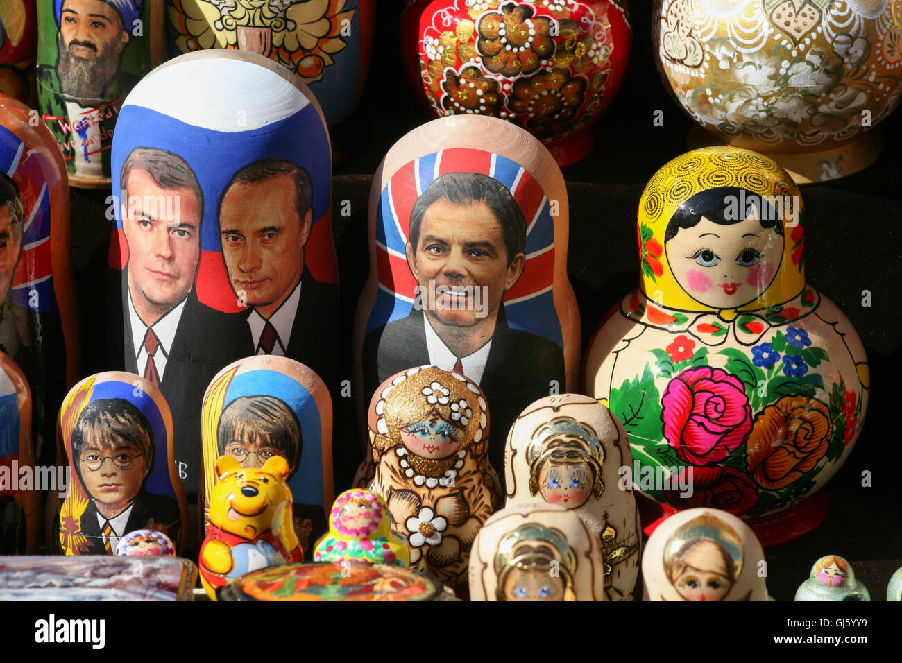 Matryoshka doll /Russian Dolls,with typical motherly images along with dolls of Tony Blair, Medvedev+Putin,Harry - Stock Image