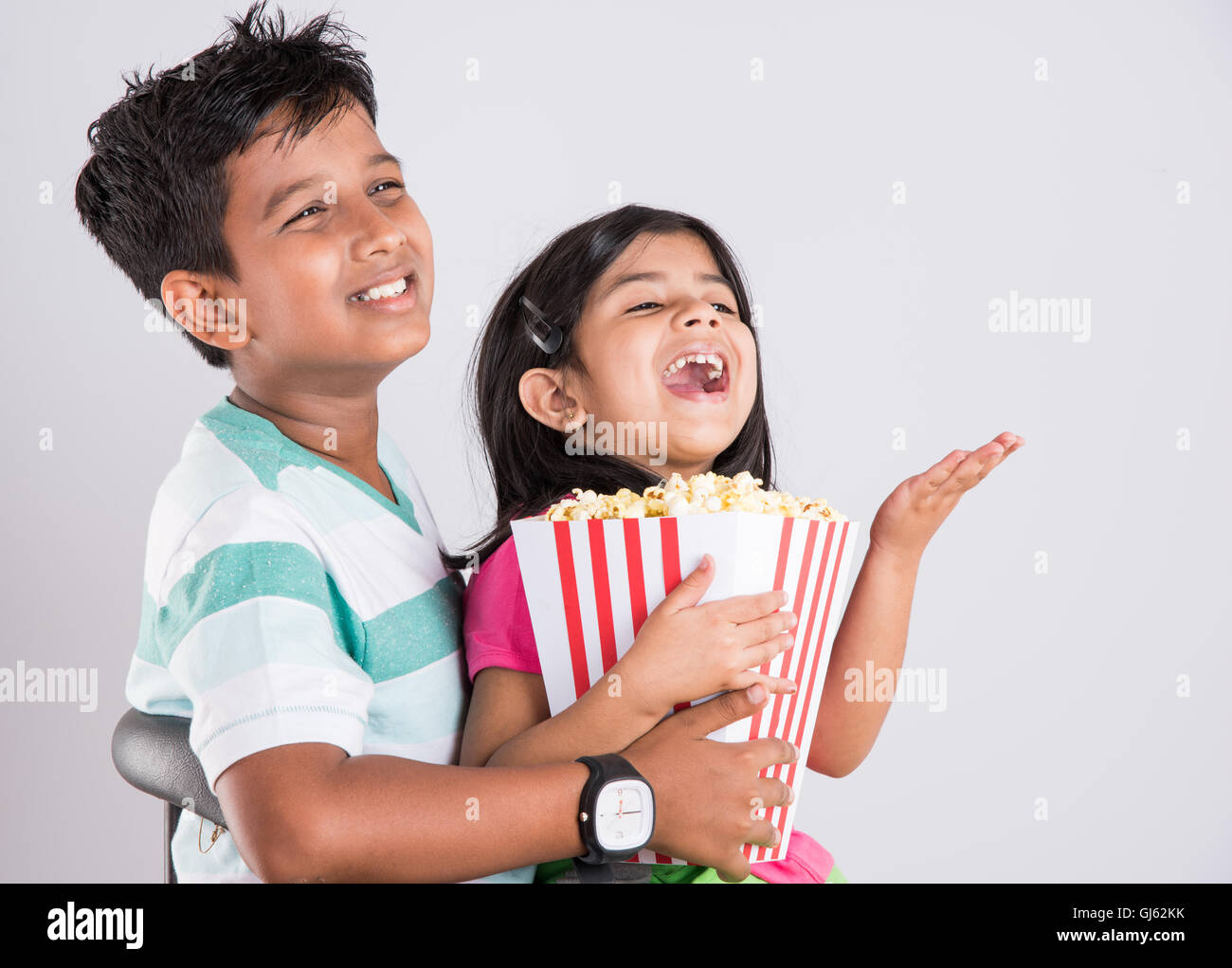 Indian Cute Girl And Boy Eating Popcorn Asian Kids And Popcorn Little Girl And Little Boy Enjoy Eating Popcorn And Tv