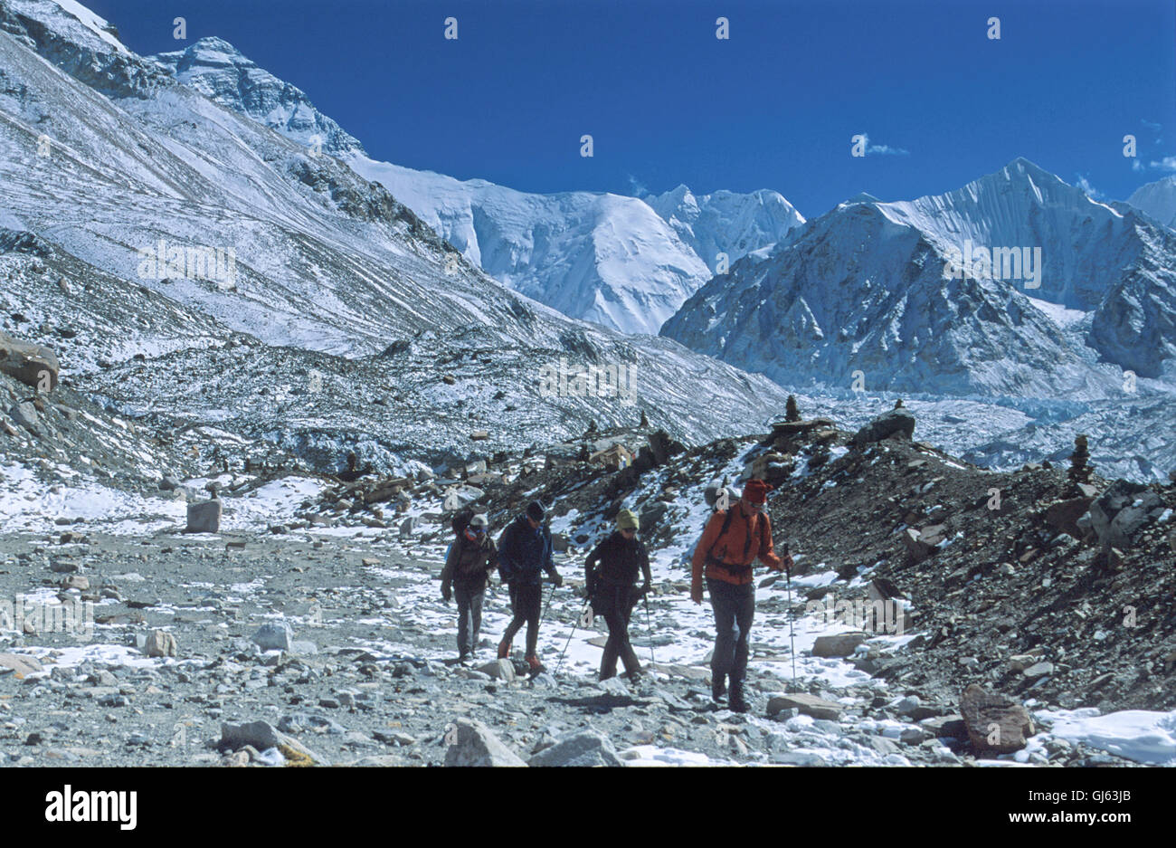 Four  American  trekkers  on  a  trail  alongside the  Rongbuk  Glacier  between  Everest  Base  Camp( 5,200 metres) - Stock Image