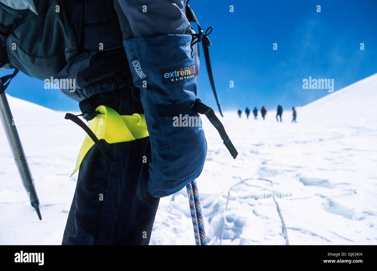 Close up shot of a British trekker with in the background our expedition group and Nepali guides on a fantastic - Stock Image