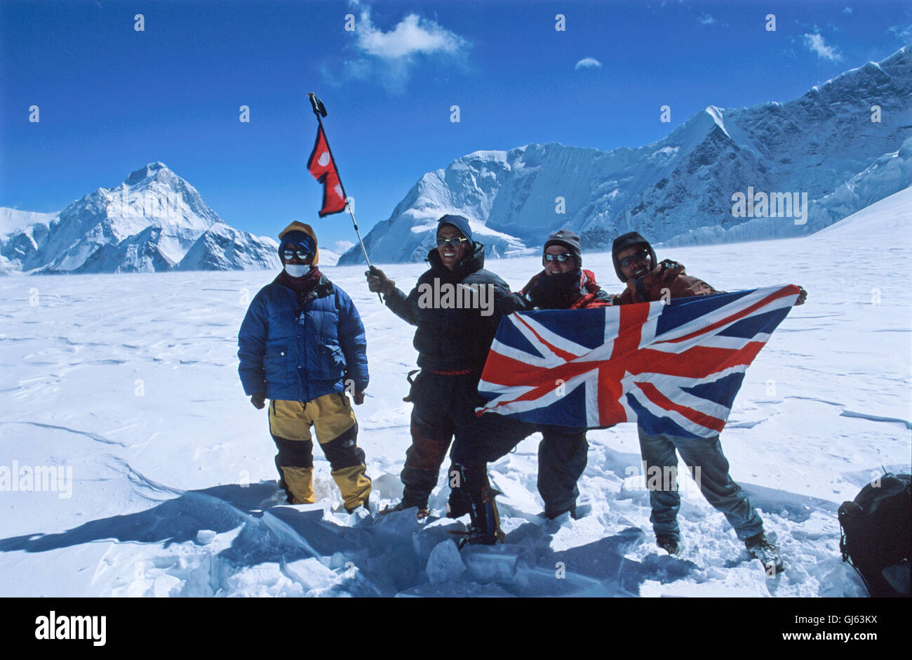 Our  expedition  group  and  Nepali  guides  with  Nepali  flag  attached  to  ski-pole  at  Raphu  La  where  we - Stock Image