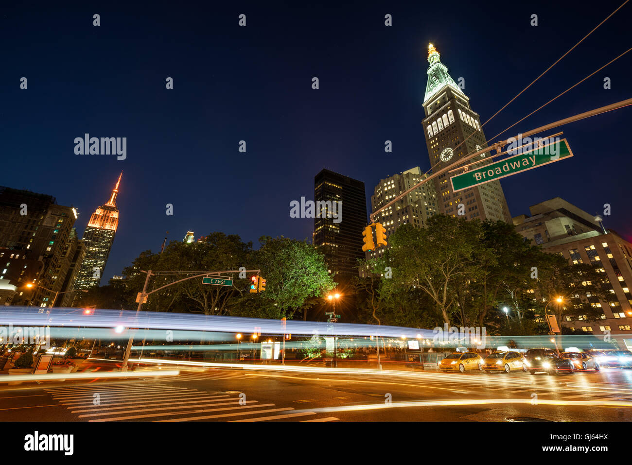 Twilight at Madison Square Park,23rd Street and Broadway with skyscrapers. Flatiron District, Manhattan, New York - Stock Image