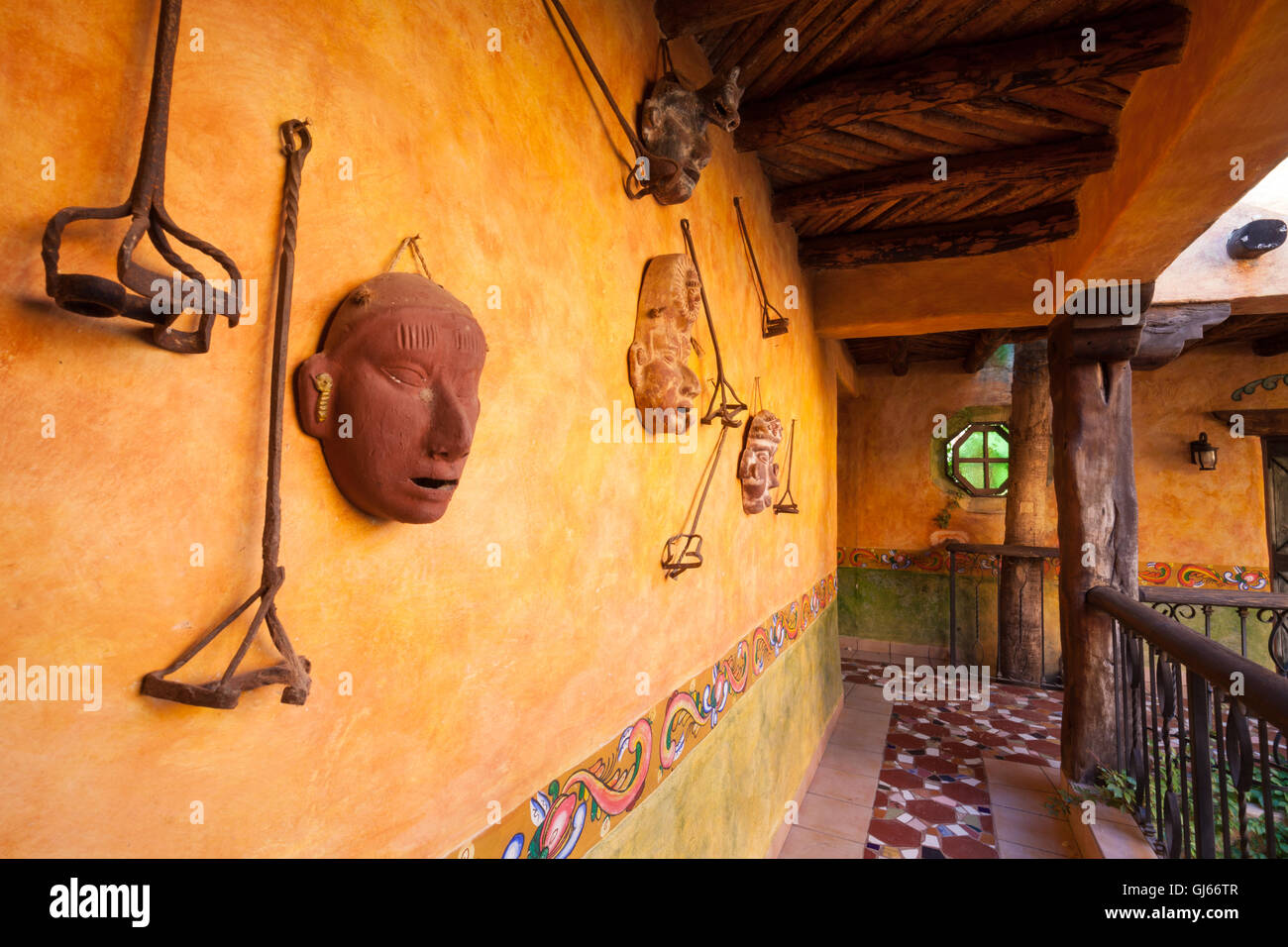 Artifacts decorate a wall of a colonial home in El Fuerte, Sinaloa, Mexico. - Stock Image