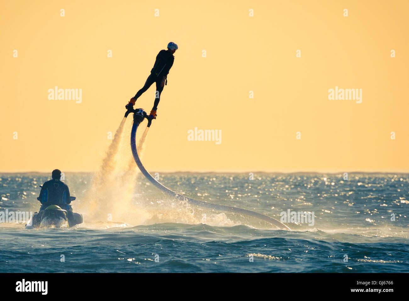 A hydro jet surfer soars over the Pacific Ocean near Maviri Beach, Sinaloa, Mexico. - Stock Image