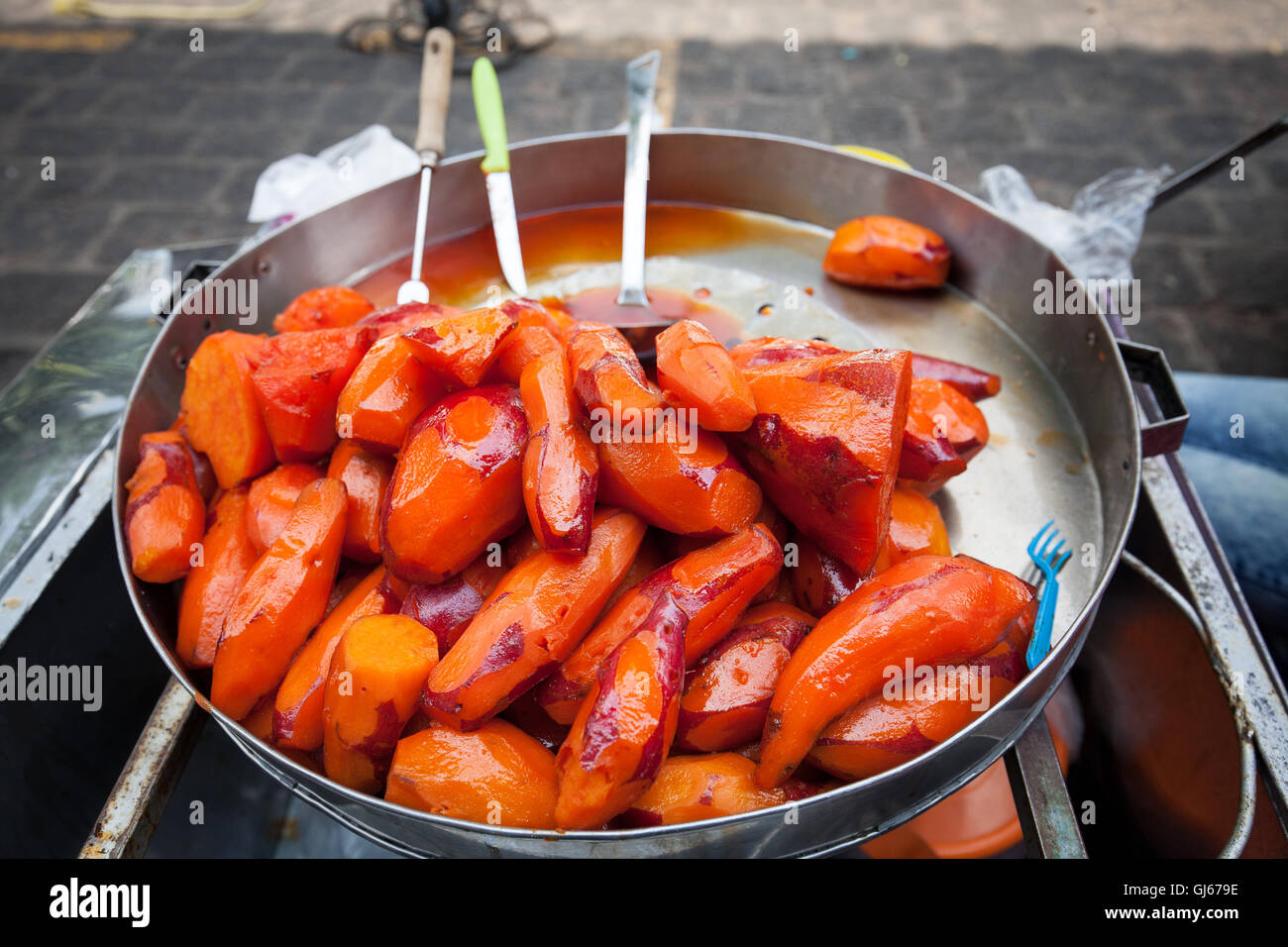 Sweet potatoes for sale near the Plaza Grande in Patzcuaro, Michoacan, Mexico. - Stock Image