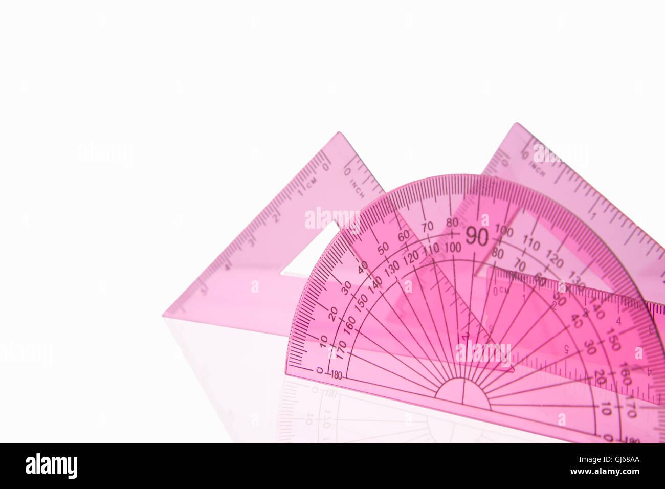 Close up shot of a pink maths set isolated on a white background - Stock Image