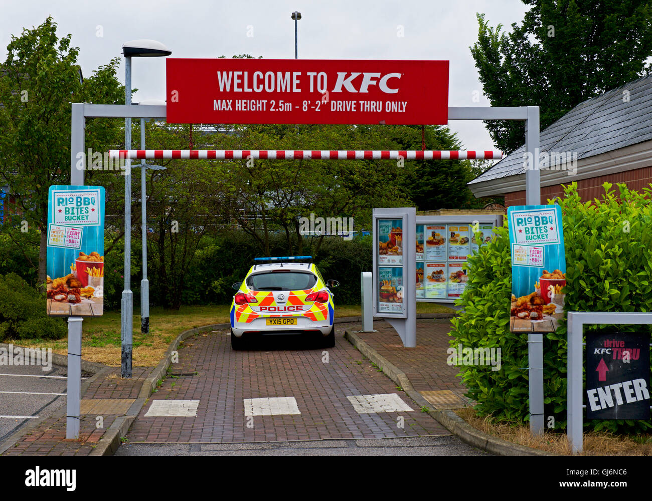 Police car at drive-in KFC take-away restaurant, England UK - Stock Image