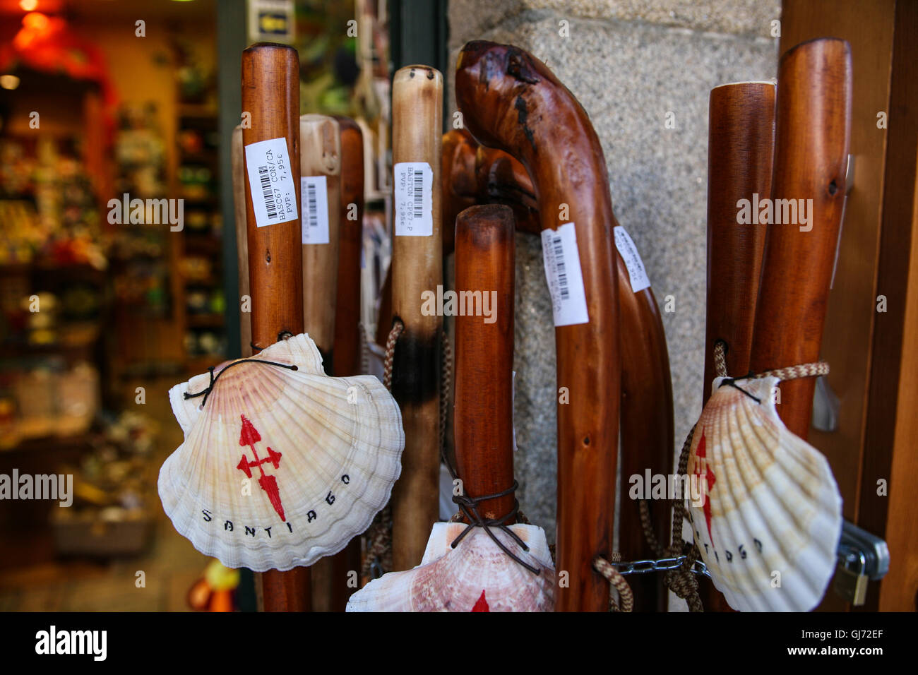 Pilgrim staff's, walking sticks for sale at this tourist shop in the Old Town of Santiago de Compestela. The - Stock Image