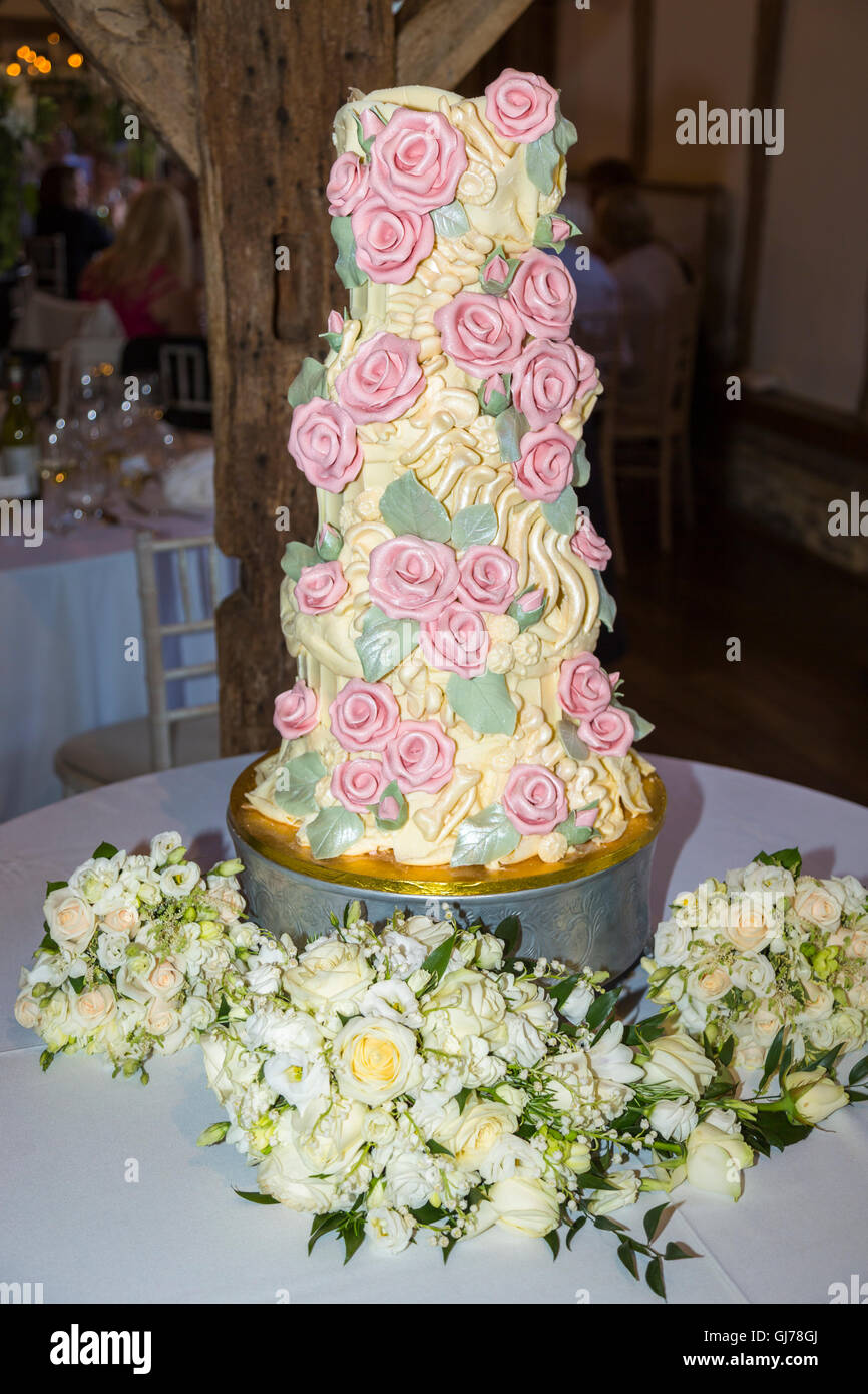 Elaborate bespoke chocolate wedding cake with chocolate pink roses and dinosaur bones including a fossil spine made - Stock Image