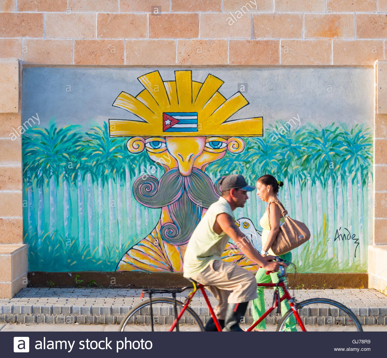 Cuban people lifestyle and anti war art painted by Cubans humorists in a large city wall. - Stock Image