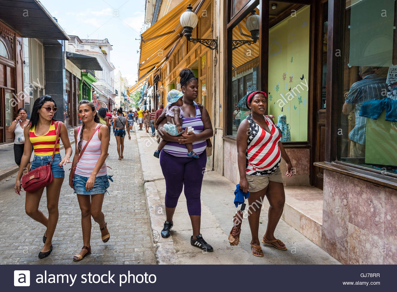 Woman wearing a U.S.A flag in a Cuban everyday scene. After the thaw of relations between the two countries American - Stock Image