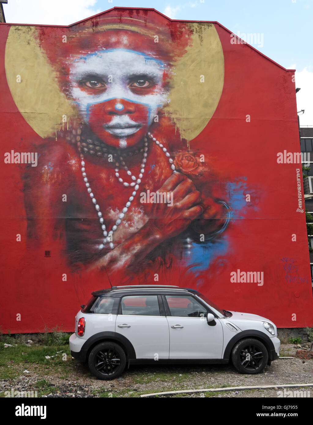 Aboriginal child in car park, Northern Quarter Artwork, NQ, Manchester, North West England, UK, M1 1JR - Stock Image