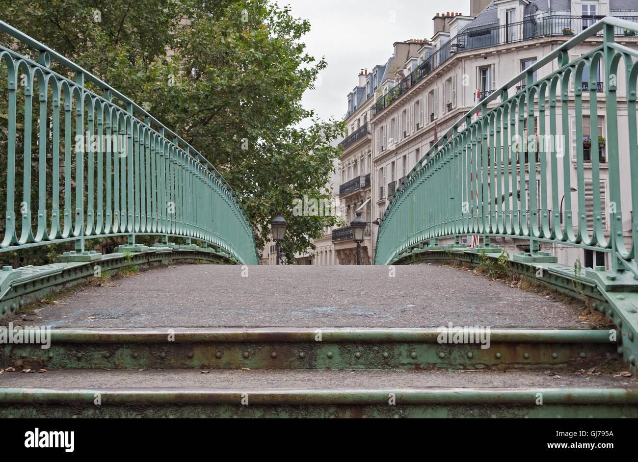 pedestrian bridge over the Saint Martin canal in Paris France - Stock Image