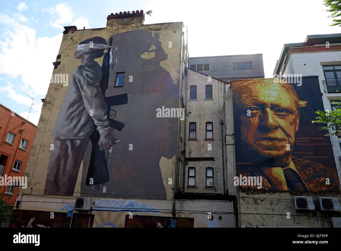 Author Anthony Burgess mural art work, with blindfolded child holding gun, Northern Quarter, Brightwell walk, Manchester - Stock Image