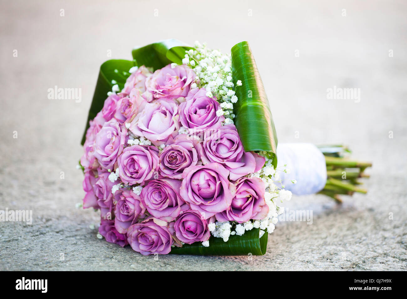 Wedding bouquet of pink roses lying on the ground Stock Photo ...