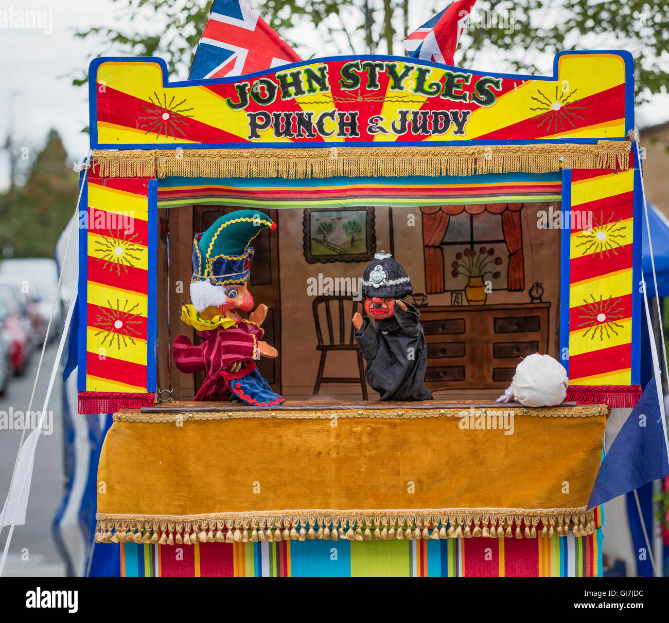 Mr Punch and Mr Policemen puppets at a Punch and Judy puppet booth Stock Photo