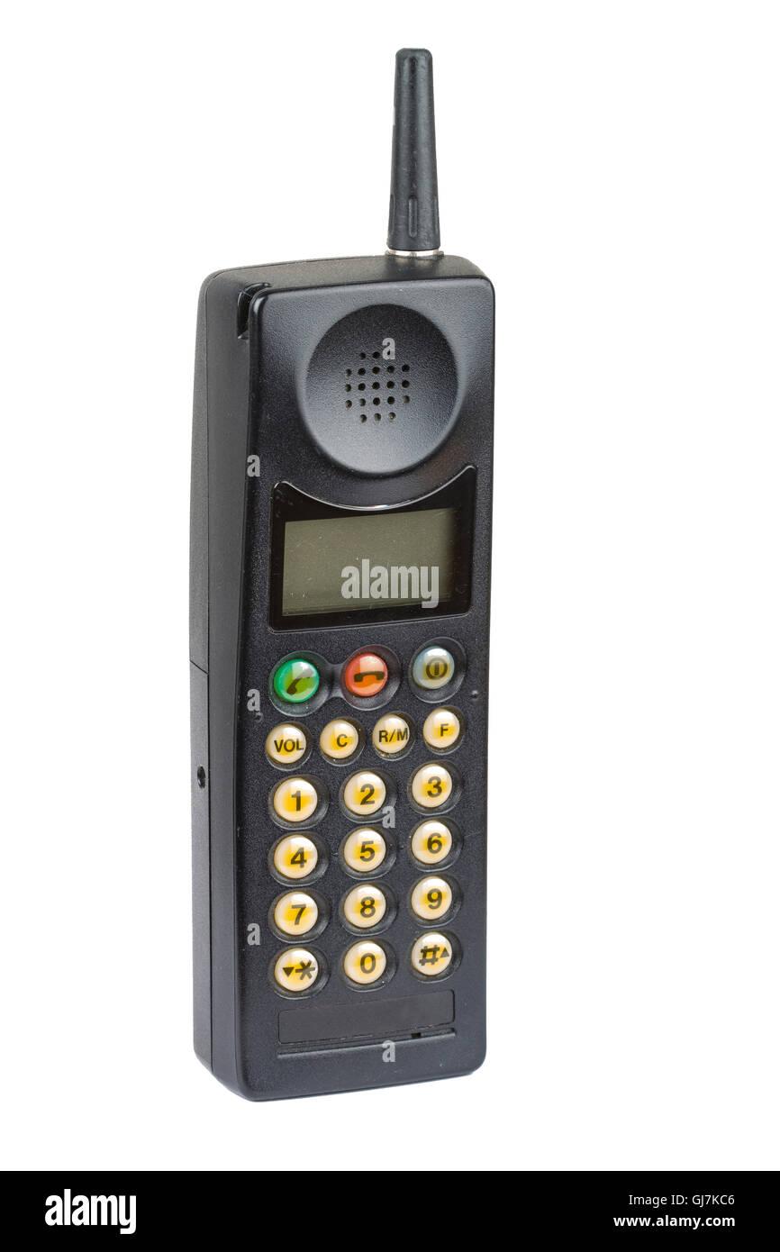 Old fashioned black mobile phone on plain background - Stock Image