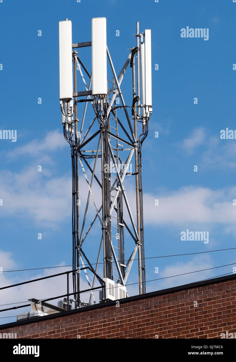 Communication aerials - mast - on top of building - Junction Road, Totton, Hampshire, England, UK - Stock Image