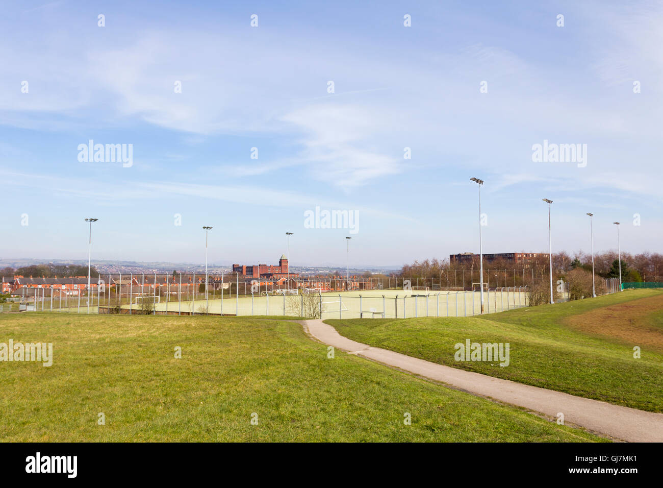 All-weather floodlit sports pitch at Harper Green playing fields, Farnworth, Lancashire. - Stock Image