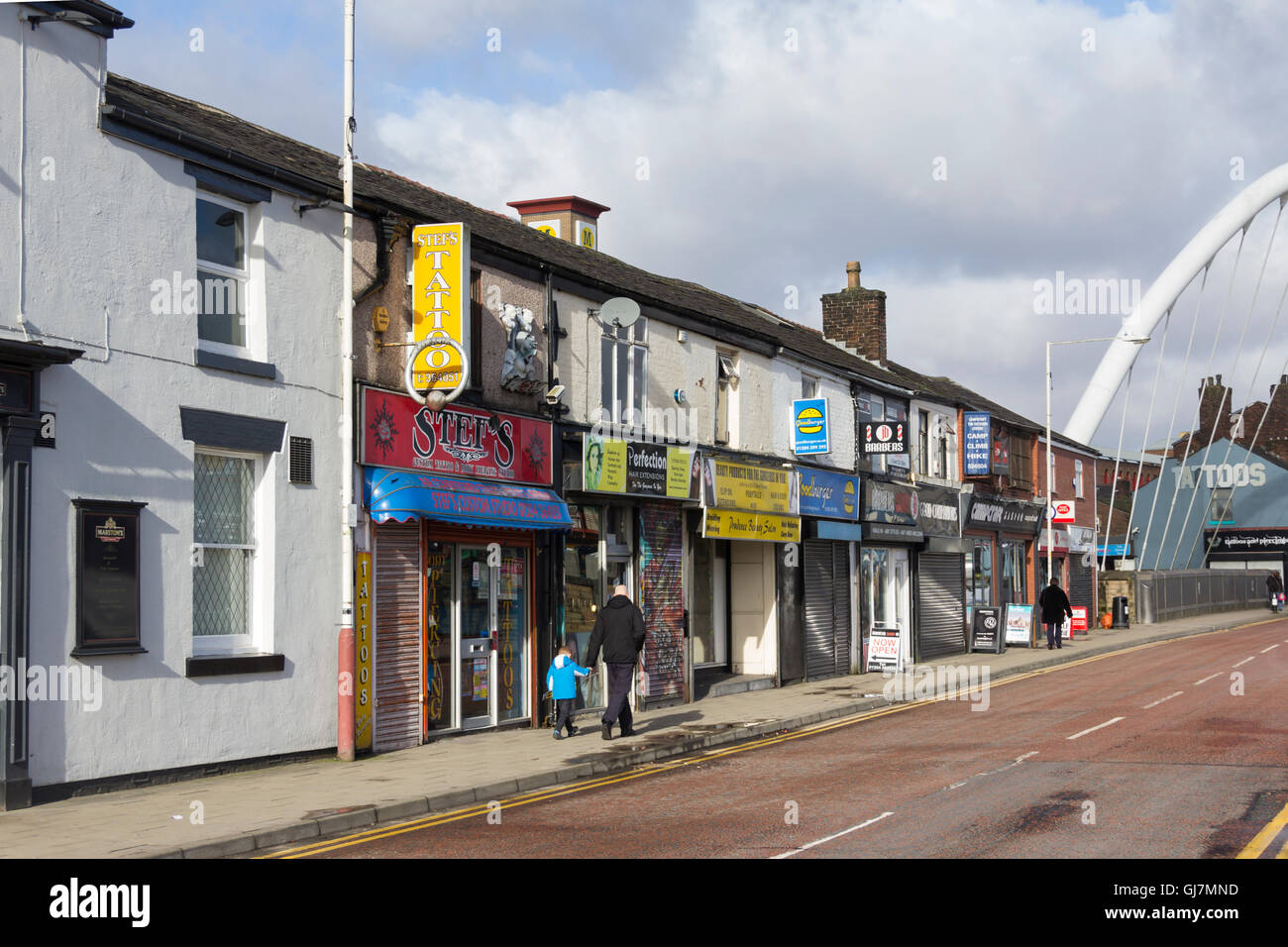 Shops on Newport Street, on the fringe of Bolton town centre, mostly specialising in aspects of the cosmetic body - Stock Image