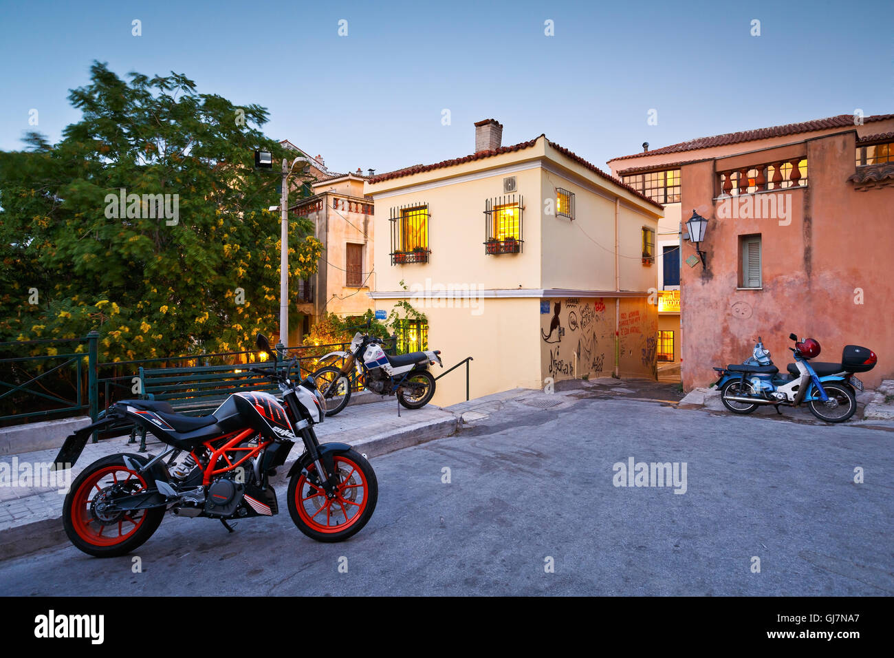 Motorbikes in a street in the old town Plaka, Athens. - Stock Image