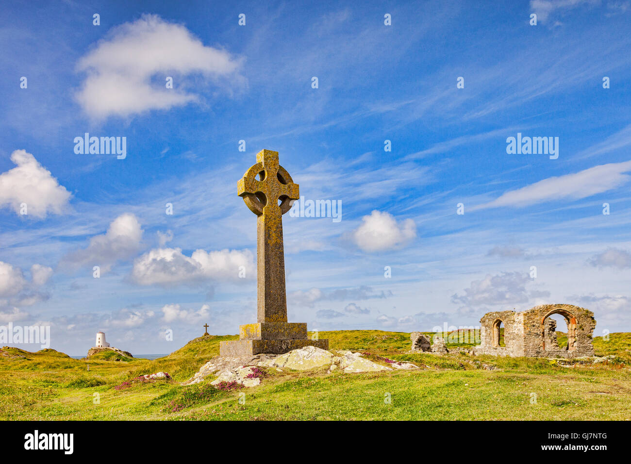 Llanddwyn Island, with the Old Lighthouse, a Celtic Cross and the Church of St Dwynwen, Anglesey, Wales, UK - Stock Image
