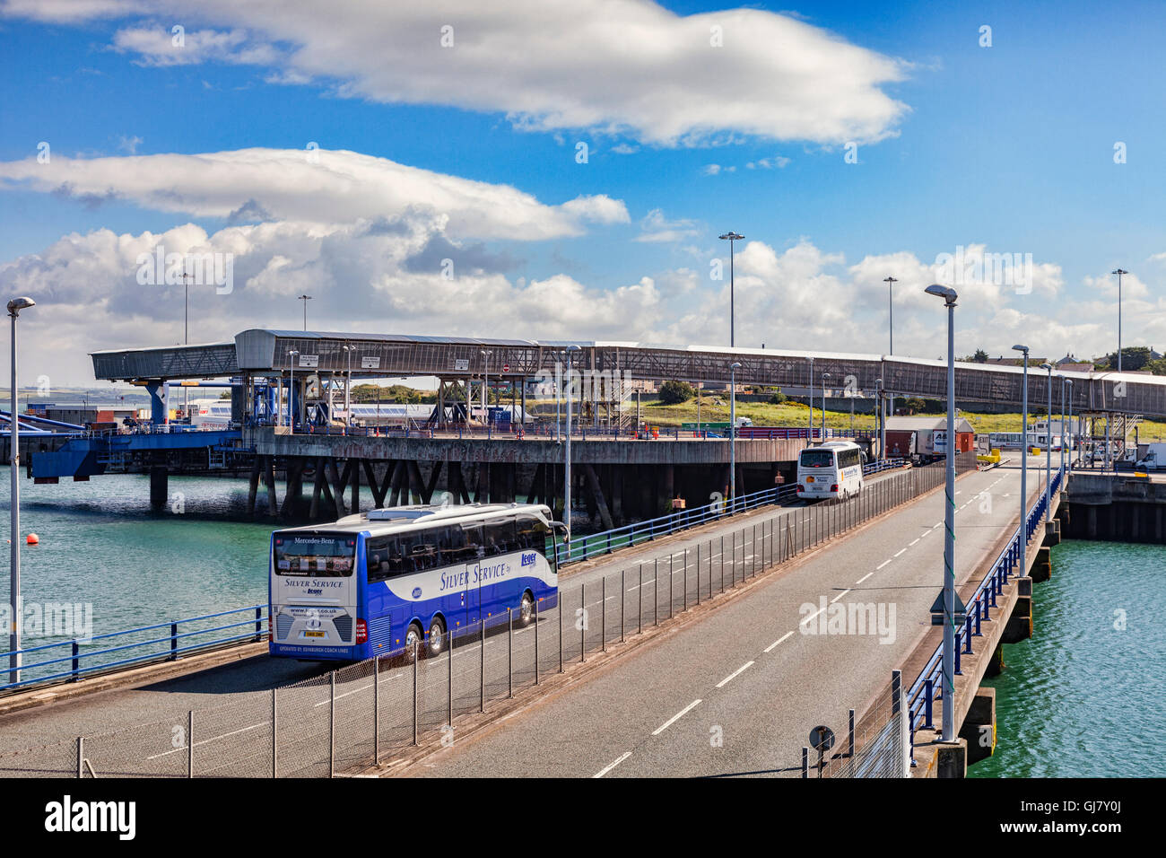 Coaches approaching Holyhead Ferry Terminal, Anglesey, Wales, UK - Stock Image