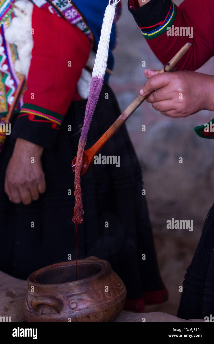 Close up of yarn being dyed in different colors using traditional techniques in the mountains of Peru Stock Photo
