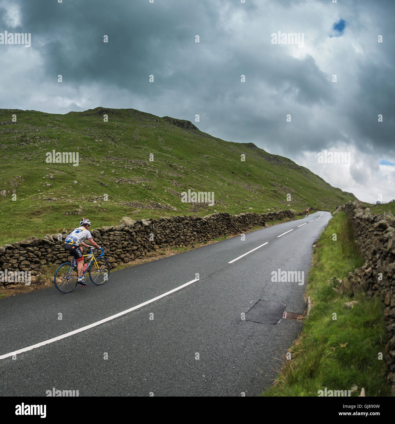 Cyclist taking part in the Mighty Corinthian vintage cycling event in Cumbria, UK. - Stock Image
