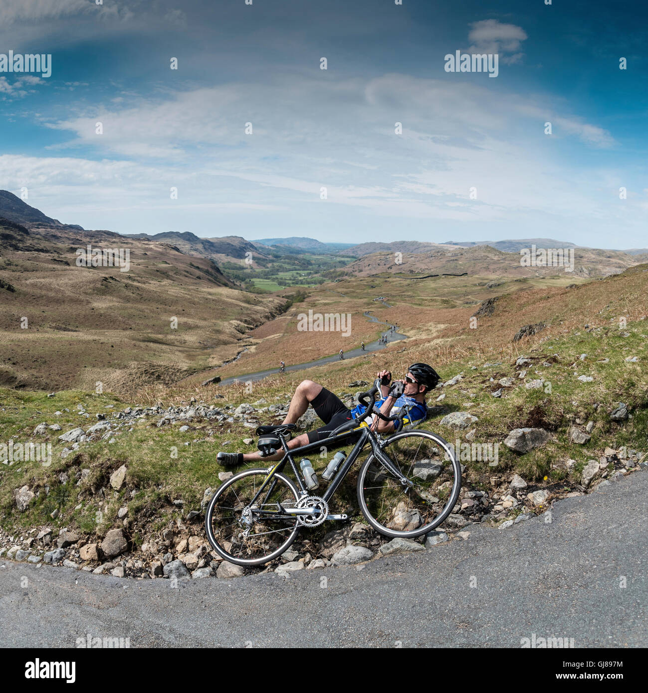 Rider in the Fred Whitton Challenge cycling Hardknott Pass, Cumbria, UK. - Stock Image