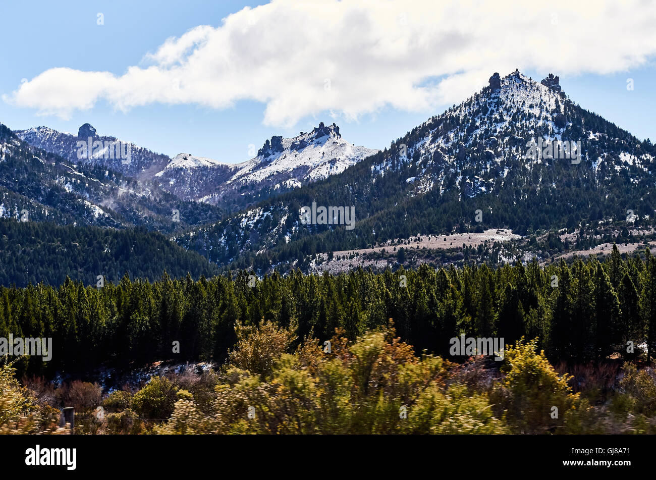 Some huge mountains in the distance in the Enchanted Valley in San Carlos de Bariloche, Argentina. - Stock Image