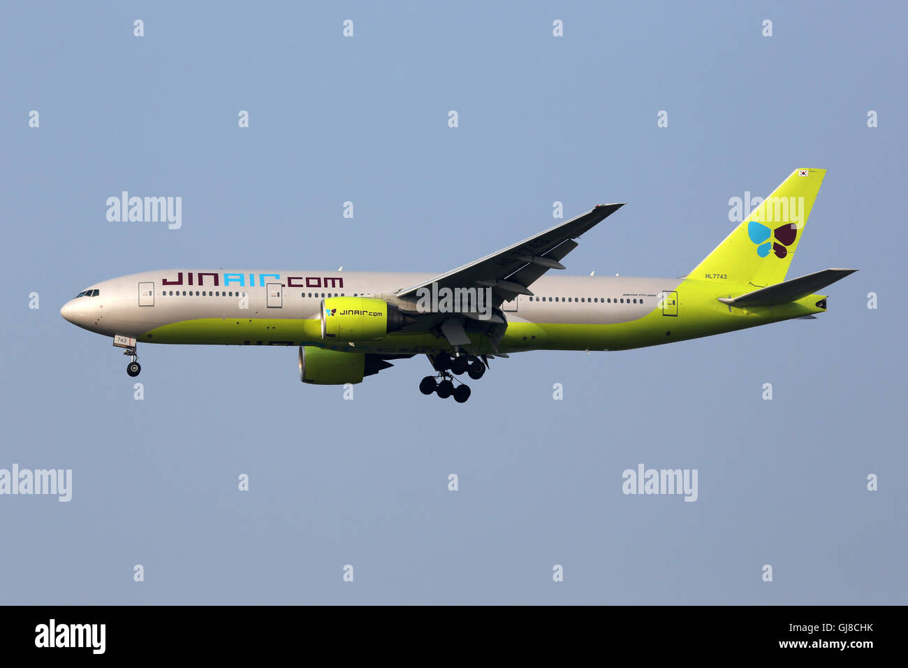 Incheon, South Korea - May 24, 2016: A Jin Air Boeing 777-200 airplane with the registration HL7743 approaching - Stock Image