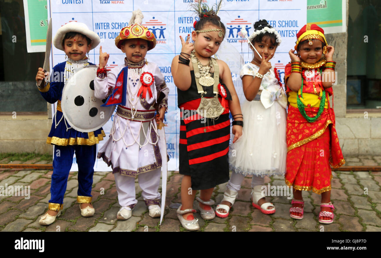 Kathmandu, Nepal. 13th Aug, 2016. Kids dressed up as professionals pose before performance during the Inter School - Stock Image