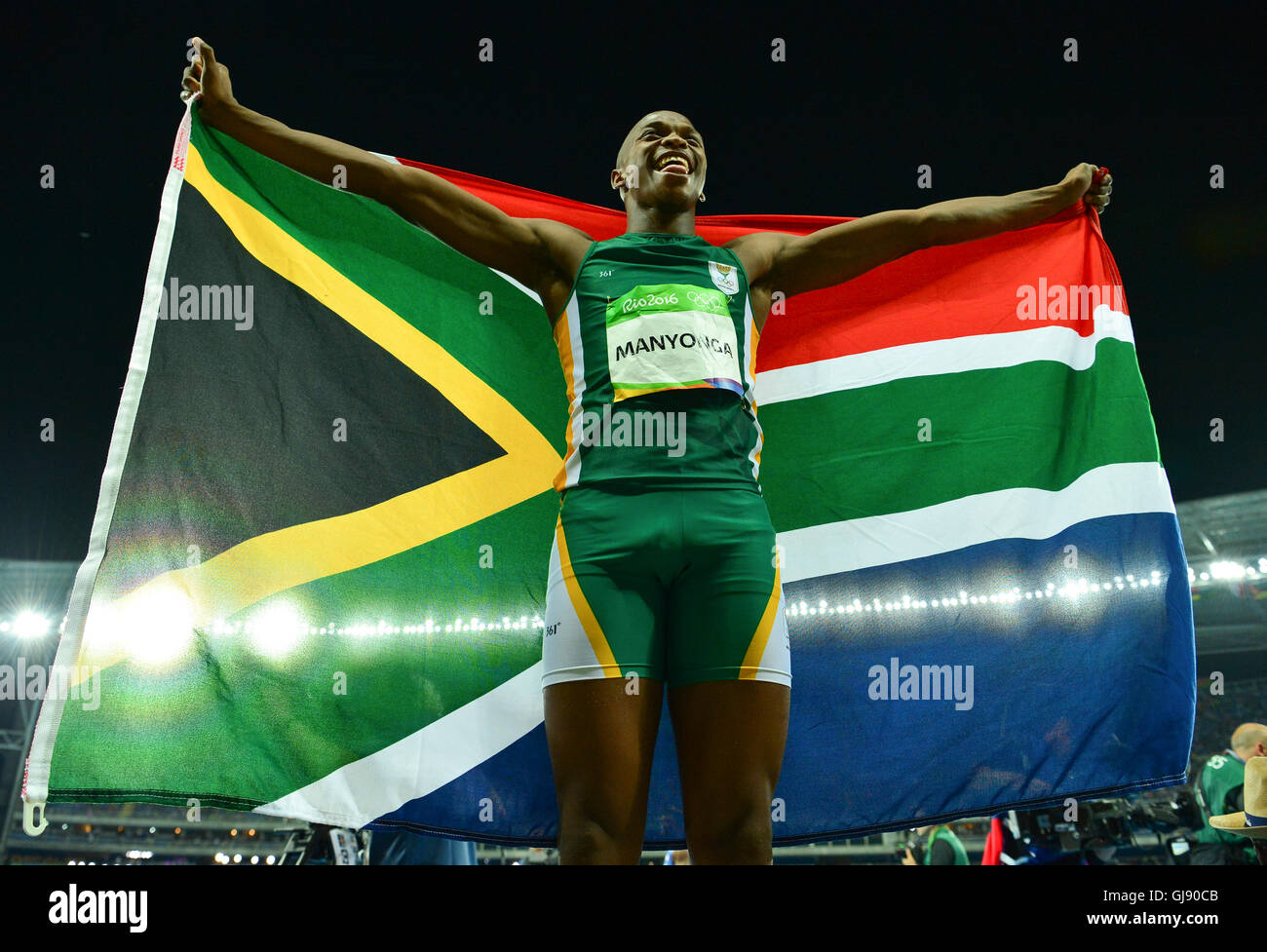 RIO DE JANEIRO, BRAZIL - AUGUST 13: Luvo Manyonga of South Africa hold the South African national flag high after - Stock Image