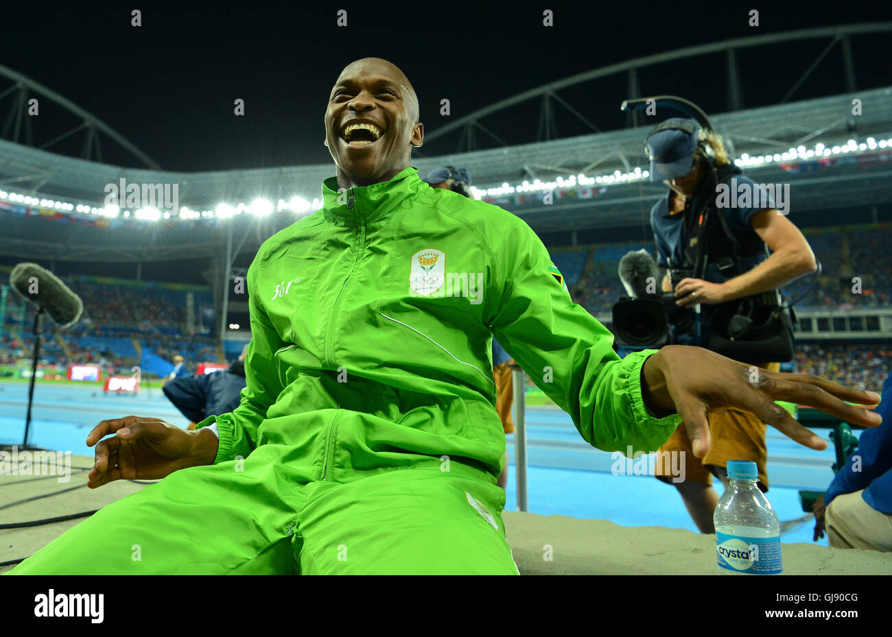 RIO DE JANEIRO, BRAZIL - AUGUST 13: Luvo Manyonga of South Africa smiles after wining the silver medal in the mens - Stock Image
