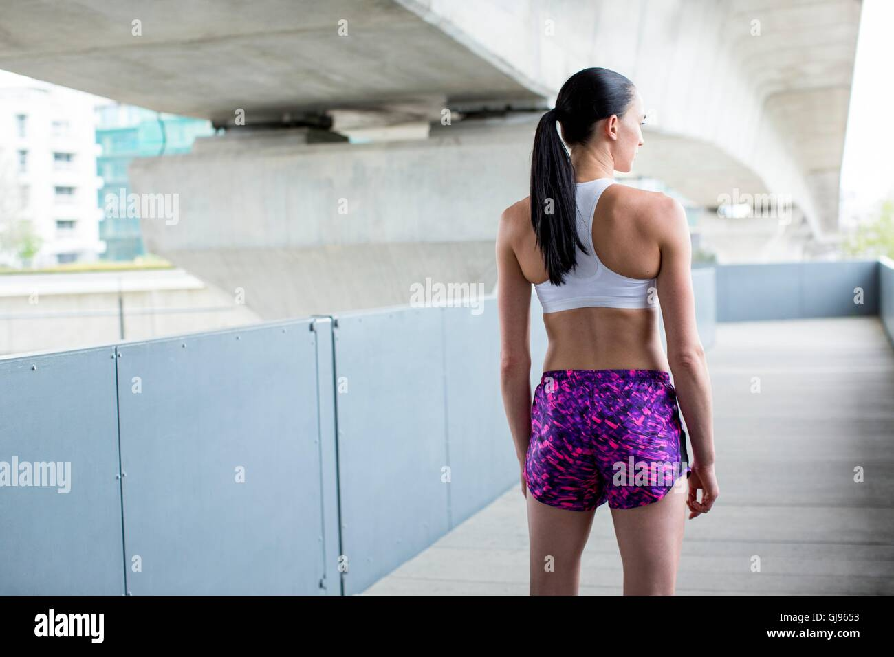 MODEL RELEASED. Portrait of young woman in crop top and shorts. - Stock Image