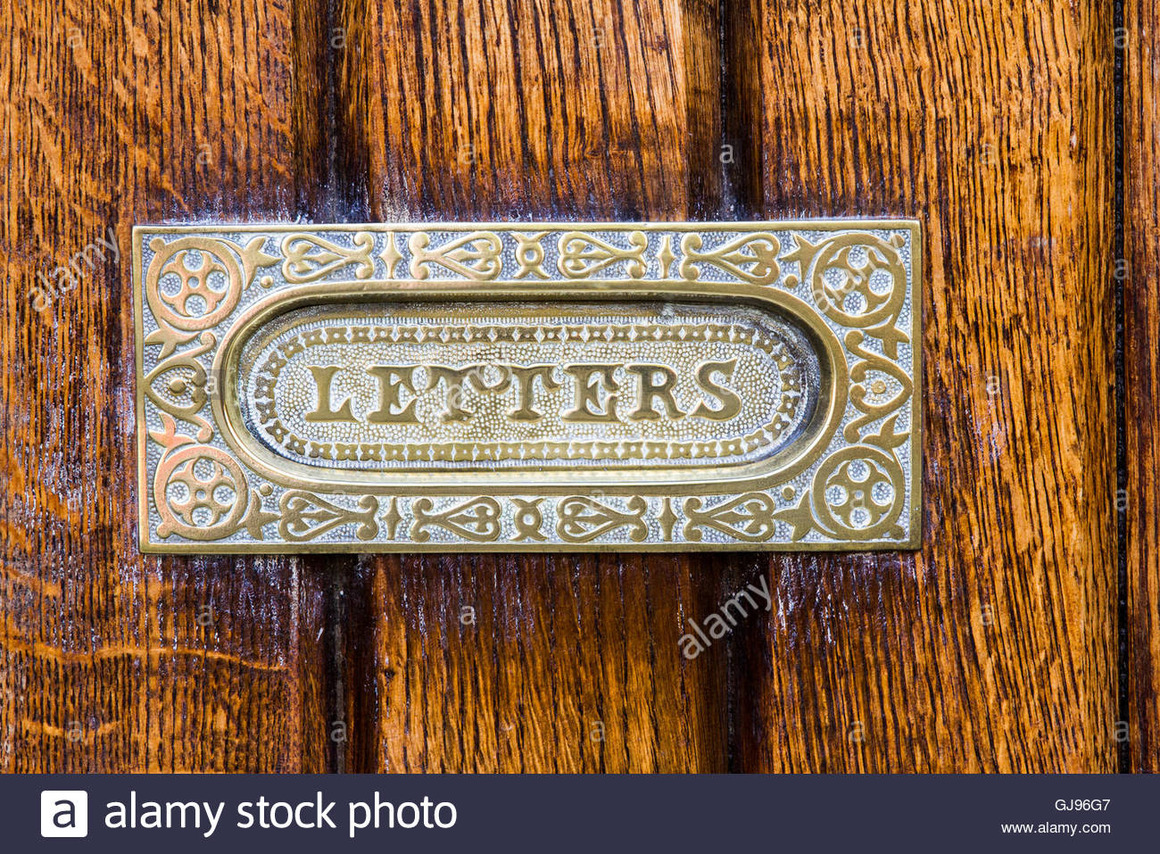 Brass letter box stock photos brass letter box stock images alamy close up of a vintage letter box in a wooden door stock image spiritdancerdesigns Image collections