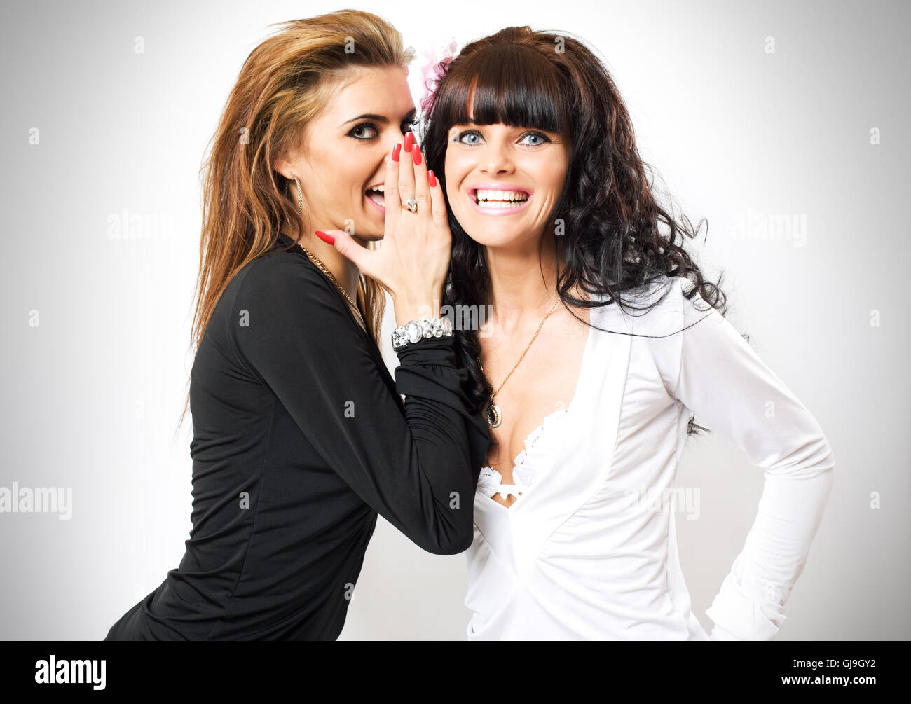 girls have secrets - Stock Image