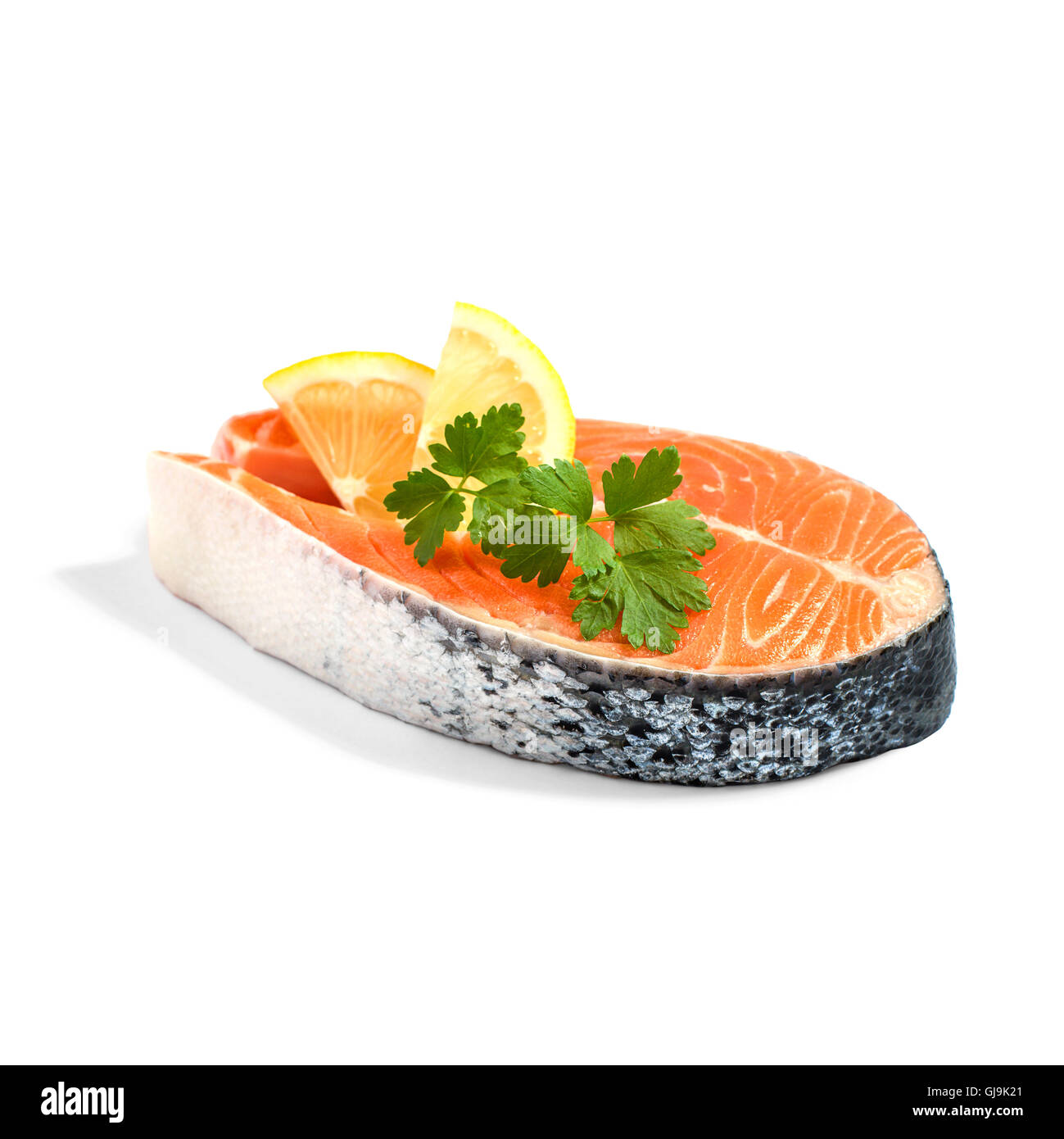 Salmon steak with lemon slice and parsley, isoliert - Stock Image