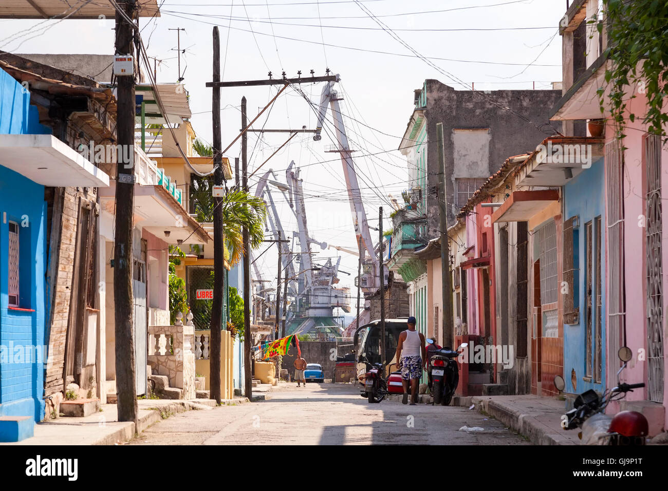 Heavy industry bordering a neighbourhood in the municipality of Regla, Havana, Cuba. - Stock Image