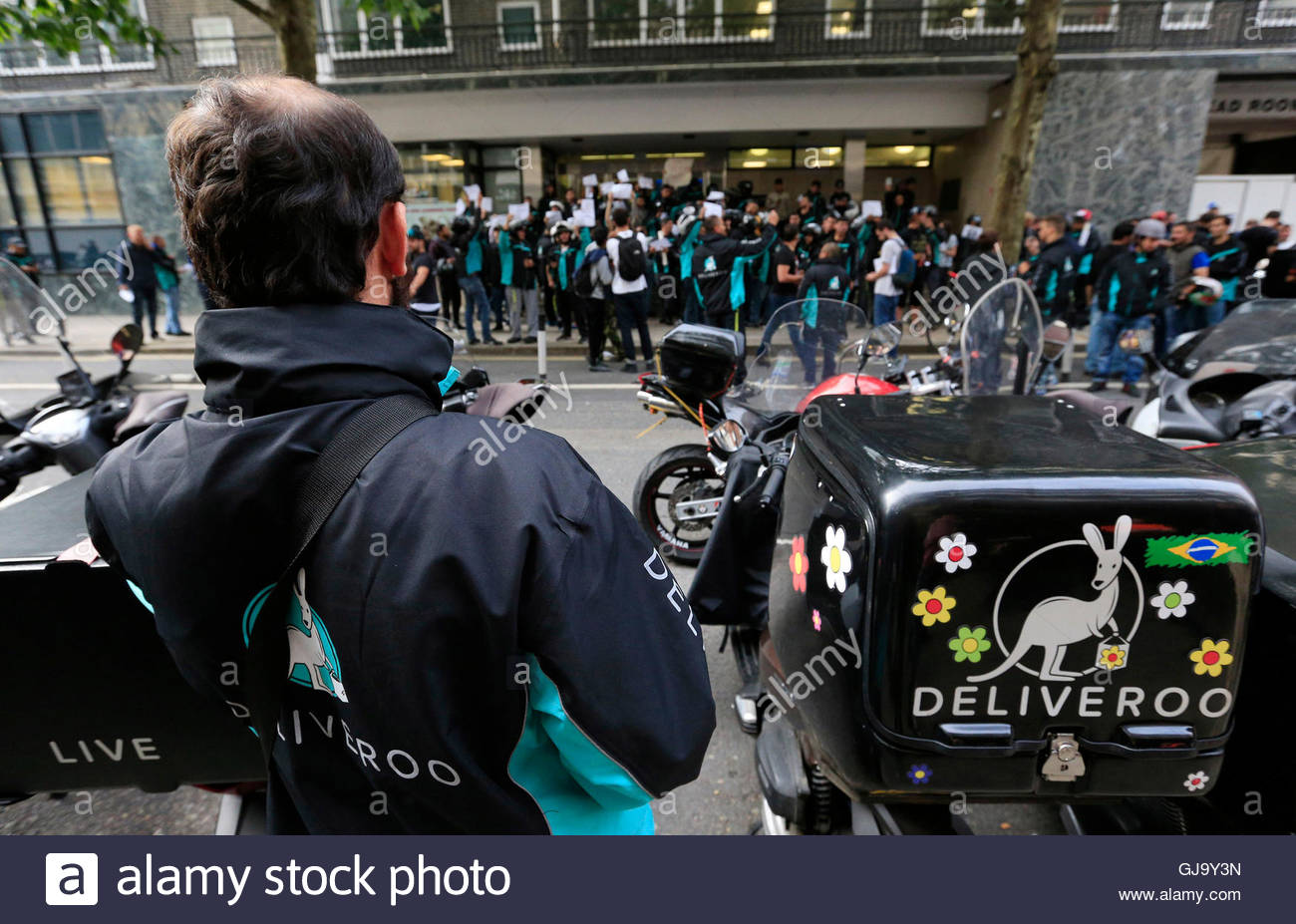 File photo dated 11/08/16 of Deliveroo riders holding a protest over pay outside the company HQ in London, as the - Stock Image