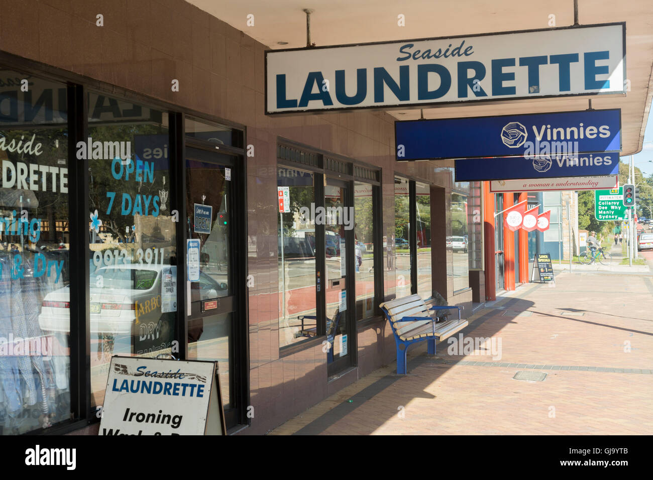 Laundrette and Vinnies charity shop in narrabeen, north Sydney,Australia - Stock Image